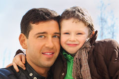 Father and son hug outdoor. Happy father and his little son wearing in jacket hug outdoor in spring Stock Photography