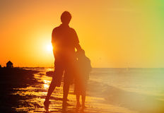 Father and son hug at sunset Royalty Free Stock Photos
