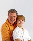 Father and son hugging. Father and son have fun and hugging together Stock Photo