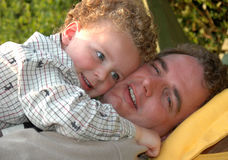 Father and Son Hugging. In te garden Royalty Free Stock Photography
