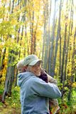 Father and Son Hugging in Autumn Forest royalty free stock image