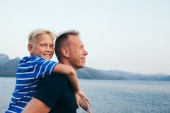 Father and son hugging. Father and son together. Son hugging father. Summer vacation stock image