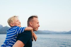 Father and son hugging. Father and son together. Son hugging father. Summer vacation. Selective focus royalty free stock photos