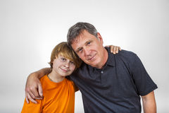 Father and son hugging. Happy father and son hugging isolated on white Stock Image