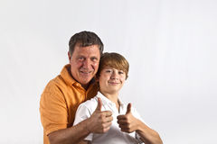 Father and son hugging. Father and son have fun and hugging together royalty free stock photo