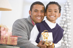 Father And Son Hugging,Holding Christmas Gift.  stock image