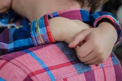 Father and son hugging in love. Hands close up Royalty Free Stock Images