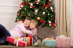 Father and son hugging next to Christmas tree. new year. Father and son hugging next to Christmas tree.  new year Stock Image