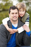 Father And Son Hugging Outdoor Stock Images