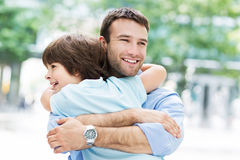 Father and son hugging. Outdoors Royalty Free Stock Photos