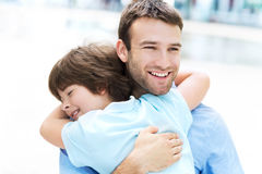 Father and son hugging Stock Images