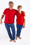 Father and son hugging. Father and son in red shirts hugging Stock Images