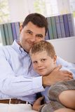 Father and son hugging smiling Stock Photography
