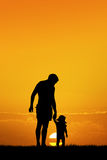 Father and son. Illustration of father and son at sunset Royalty Free Stock Photos