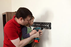 Father with son installing mount TV Royalty Free Stock Photos