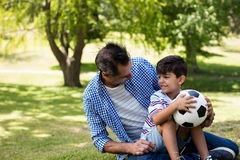 Father and son interacting with each other in park Stock Image