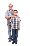 Father and son isolated on white. Father and son standing next to each other, isolated on white background Royalty Free Stock Image