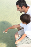 Father and son on jetty Royalty Free Stock Photo