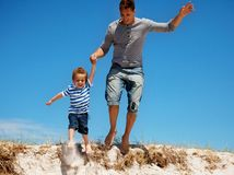 Father and Son Jumping Outdoors Royalty Free Stock Image
