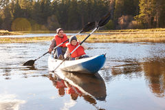 Father and son kayaking on lake, Big Bear, California, USA Stock Photo