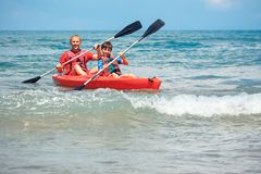 Father and son kayaking in ocean. Active vacation with young kid. Holiday activity with schoolboy child stock photography