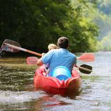 Father and son kayaking on the river royalty free stock image