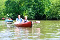 Father and son kayaking on the river Royalty Free Stock Photography
