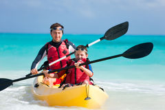 Father and son kayaking Stock Images