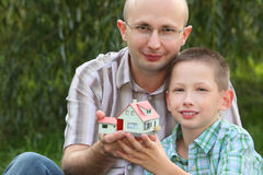 Father and son keeping in their hands wendy house Stock Photo