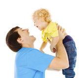 Father and Son Kid, Dad Playing with Child, Happy Parent. Raising up Boy on Hands Stock Photos