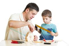 Father and son kid making wooden nesting box Royalty Free Stock Image