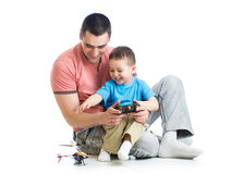 Father and son kid playing kids helicopter game Stock Photo