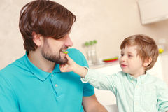 Father and son at the kitchen Royalty Free Stock Photos