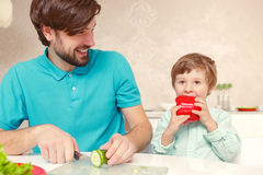 Father and son at the kitchen Royalty Free Stock Photography
