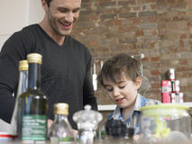 Father And Son In Kitchen Stock Image