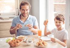 Father and son in kitchen Stock Images