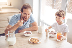 Father and son in kitchen Royalty Free Stock Image