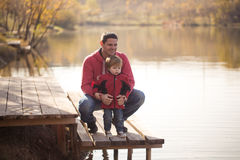 Father with son on the lake. Father with son on the shore of the lake Stock Photography