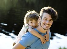 Father with son on lake, summer vacation. Together family Royalty Free Stock Images