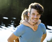Father with son on lake, summer vacation. Together family Royalty Free Stock Image