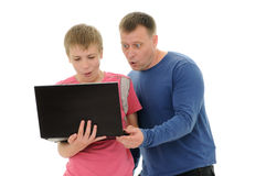 Father and  son with laptop Stock Image