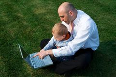 Father and son with laptop Stock Photography