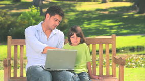 Father and son with laptop outdoors Stock Photos