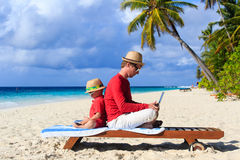 Father and son with laptop on vacation Royalty Free Stock Photo