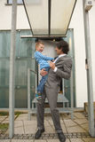 Father and son laughing at each other Royalty Free Stock Images