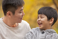 Father and son laughing in the park in autumn, close-up Stock Photography