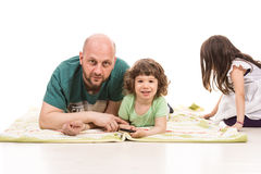 Father and son laying Royalty Free Stock Images