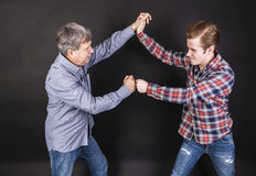 Father and son lean on back to back Royalty Free Stock Images