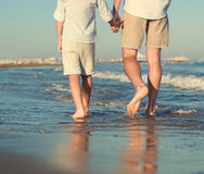 Father and son legs on the sea surfline close up image Royalty Free Stock Photo