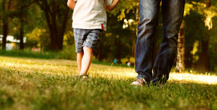 Father and son legs walk in the park